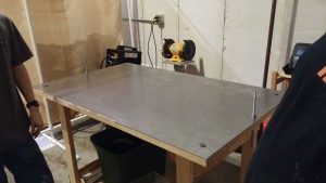Our beautiful table (with thanks to Rick for the sheet metal pickup and delivery and Nick and Carlos for getting it attached to the table and adding magnets to collect scrap/particulates)