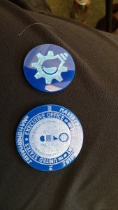 The challenge coin, next to the FamiLAB pin Ali and Willa made for me to take with me, which made it into half of my pictures!