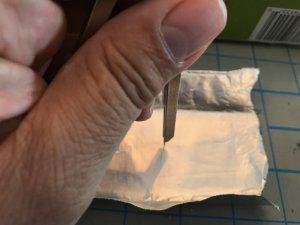 Making a pinhole in aluminum foil