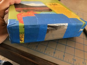 the foil pinhole taped to the box